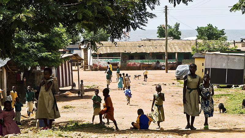 Children playing in street in village.