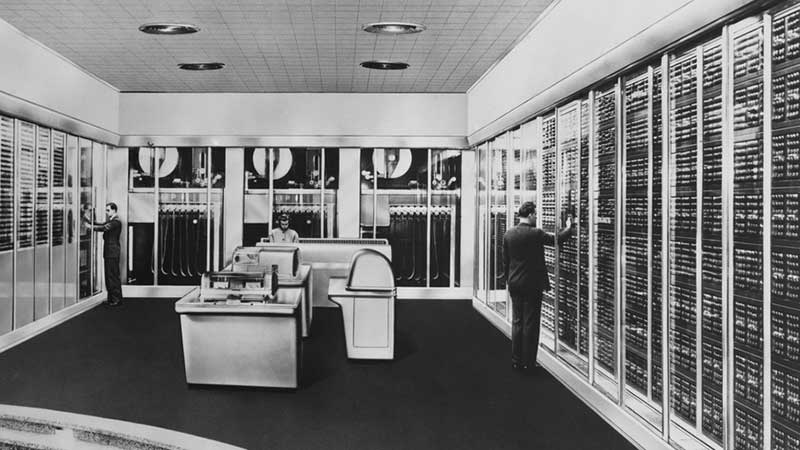 Historical photo of employees working in a computer room in the 1950s.