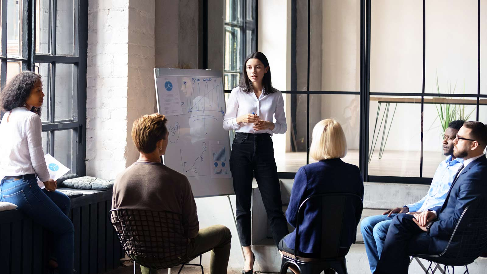 Woman leading meeting in an office.